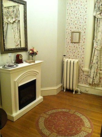 Lovelace Manor Bed and Breakfast:                                     Sitting room with TV, fire place, drinks, and a stocked cand