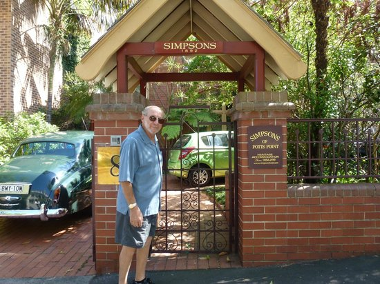 Simpsons of Potts Point Hotel:                   Jerry in front of gate
