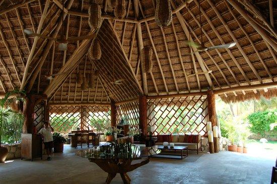 Mahekal Beach Resort: The main lobby, palapa style.