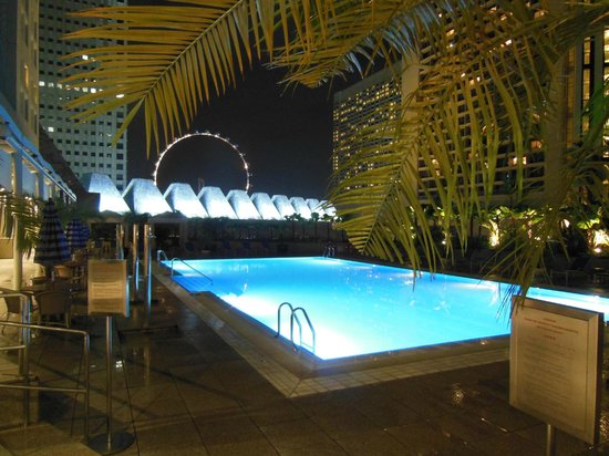 Conrad Centennial Singapore:                   Swimming pool at night
