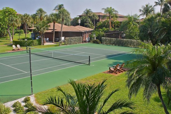Long view of tennis court at Blind Pass Condominiums