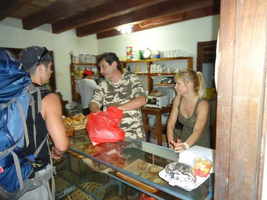 lavija panaderia:                   owners hard at work in their kitchen/bakery