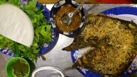 Non Nuoc Beach:                   Sting Ray with special sauce. You need to roll all the ingredients in the whit
