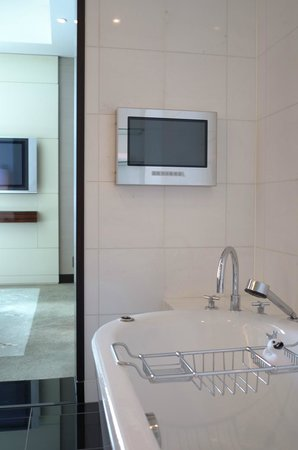Conrad Tokyo: Large TV in the bedroom, and a smaller screen in the bathroom