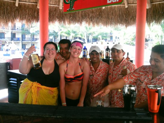 Catalonia Yucatan Beach:                   Our swim up bar bartenders! Awesome group of guys!
