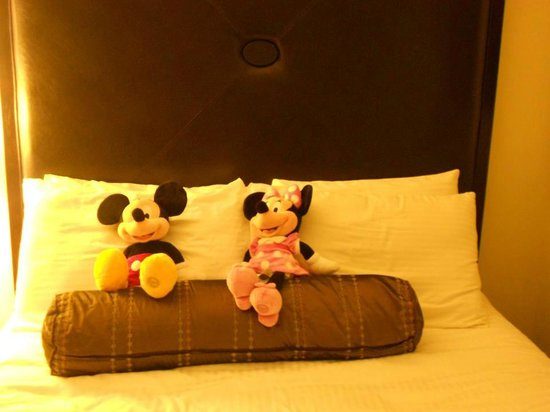Hotel Menage:                   Mickey & Minnie set up on the kid's bed - SWEET!