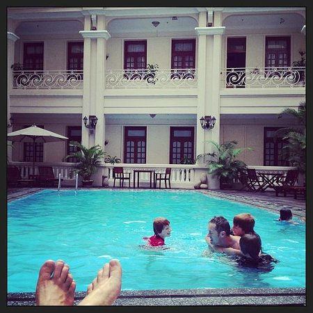 Grand Hotel Saigon:                   The peaceful pool area...our favourite place to relax and escape the busy stre