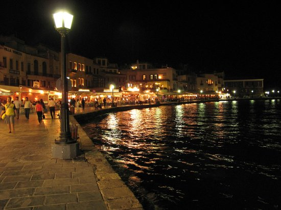 Casa Delfino Hotel & Spa:                   view of hotel from the harbor at night
