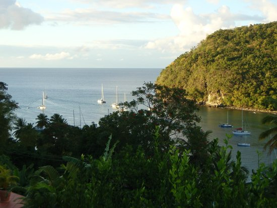Marigot Palms Luxury Caribbean Guesthouse and Apartments:                   Sailboats heading out for open ocean.
