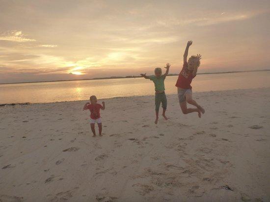 Nikoi Island:                   Kids on the main beach                 