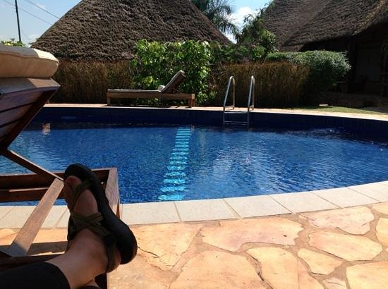 Hotel Le Petit Village:                   my feet by the pool!