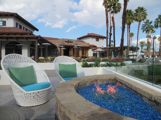 Omni Rancho Las Palmas Resort & Spa:                   Fire pit by restaurants and patio areas