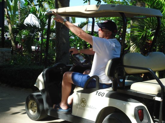 The Tropical at Lifestyle Holidays Vacation Resort: Golf cart and hubby!
