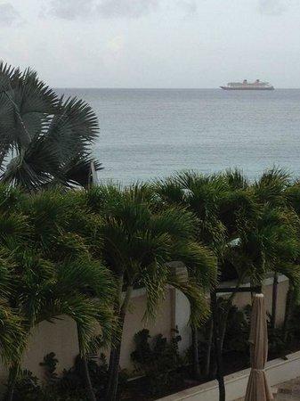 Rainbow Beach Club :                   Cruise ship arrives in distant port.