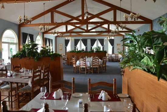 Restaurant On The Knoll:                                     Dining room with high cathedral ceilings.