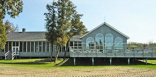 Restaurant On The Knoll :                                     A look at the restaurant from the private sandy beach.