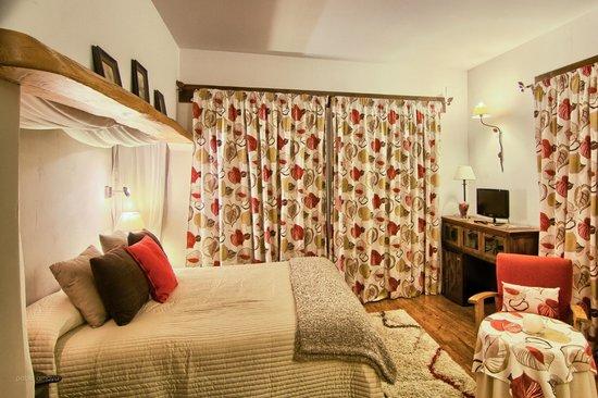 Hotel Rural Llano Tineo: Habitación de las hojas