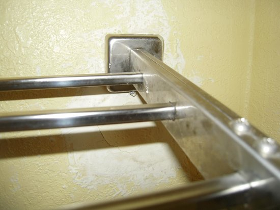 Quality Suites:                   Towel Rack was falling off the wall