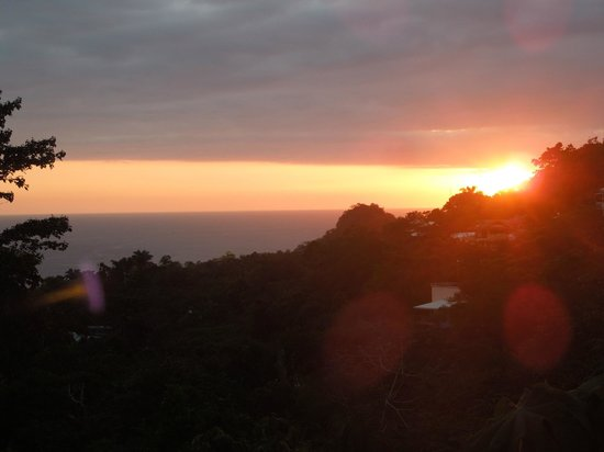Villas Nicolas:                   patio view of sunset over ocean