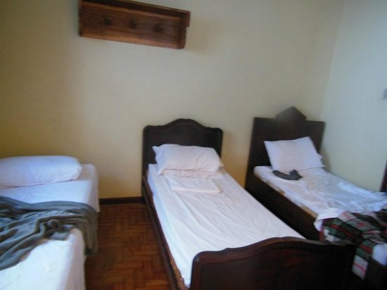 Pousada Santa Rita:                   Eram dois quartos em um