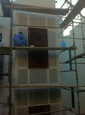 Ramee Guestline Hotel Qurum - Oman: Our curtains remained closed because of these workers!