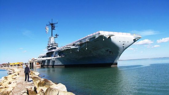 Days Inn Corpus Christi Beach:                   USS Lexington is anchored near hotel