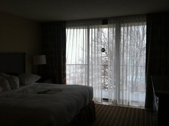 Aksarben Suites Omaha:                   Sliding glass door next to my bed to public shared balcony. This made me extre