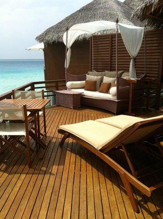 Baros Maldives:                   Day bed ourside villa