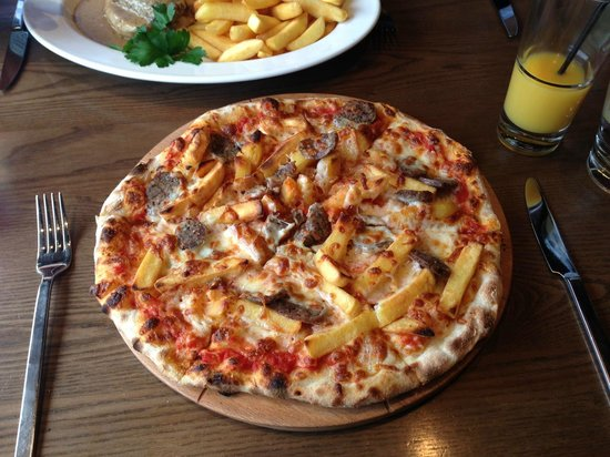 Tony Macaroni:                   Pizza and chips... literally