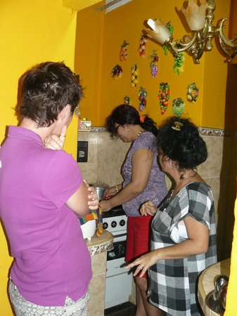 Casa Particular Isel e Ileana Havana:                   In the kitchen cooking a fantastic meal for us