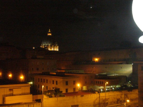 A View of Rome:                                                       St. Peter's in lights from our room...beau