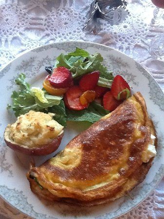 Black Walnut Bed and Breakfast Inn:                   The third of 3 courses at breakfast! A delicious omlette and twice baked potat