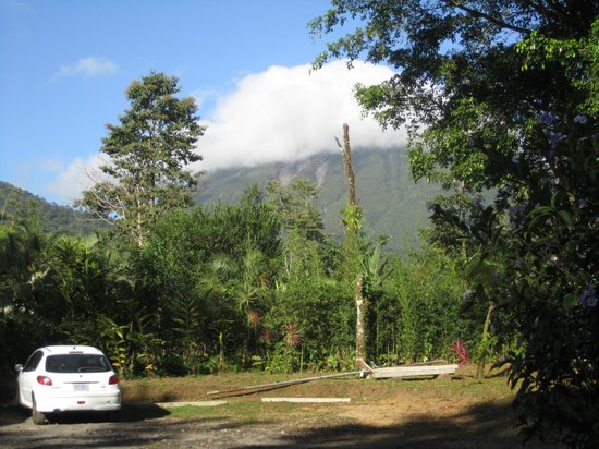 Catarata Eco Lodge S.A:                   View of Arenal Volcano (in clouds) from parking lot