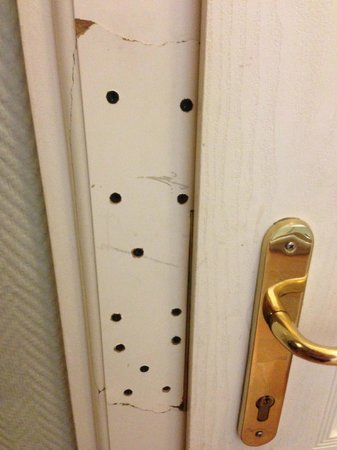 Hotel Praga 1:                   Doorframe that had been nailed back in