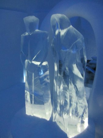 Icehotel:                   Ice figures in an ice bedroom