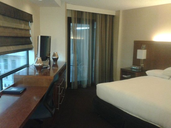 Hyatt Regency Crystal City at Reagan National Airport:                   Bedroom of suite, door in background leads to balcony.