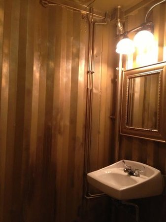 Back Alley Blues & BBQ: inside women's bathroom. the converted storage steel box nicely and simply done