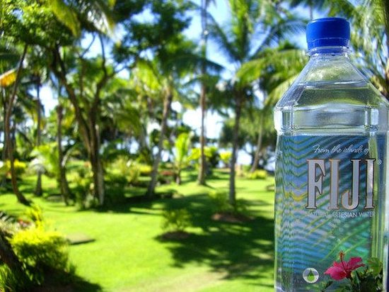 The Warwick Fiji: The view from our balcony of the mini golf course with the iconic Fijian water.