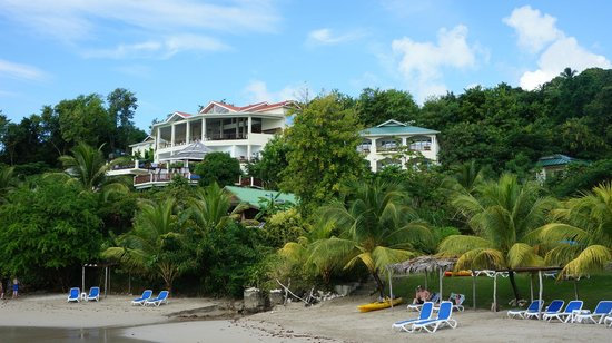 Calabash Cove Resort and Spa:                   View of the hotel from the pier