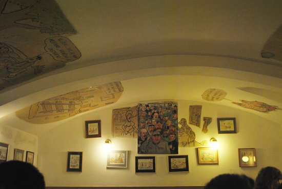 Pivnice U Pivrnce :                   Room in restaurant with interesting artwork