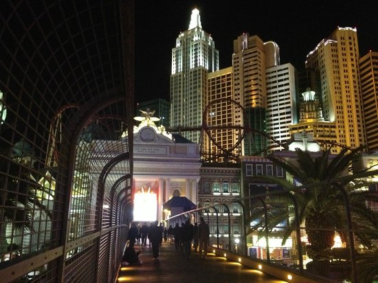 New York - New York Hotel and Casino: Night view of NYNY from Pedestrian Bridge to MGM