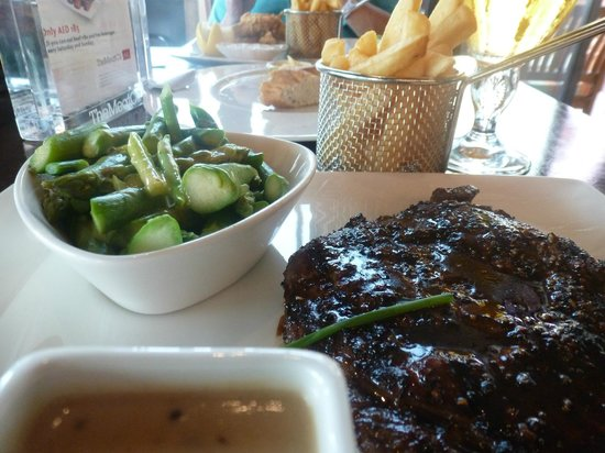 The Meat Co : with the sides, asparagus and Hollandaise sauce, steak cut chips and pepper sauce
