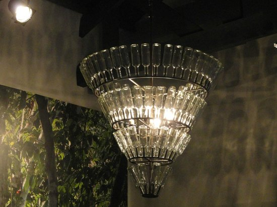 El MaPi by Inkaterra:                   Chandelier in lobby, made of simple and plain glass bottles