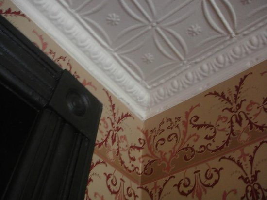 The Harlem Flophouse: These tin ceilings were added in 1917, when the building was converted into a rooming house.