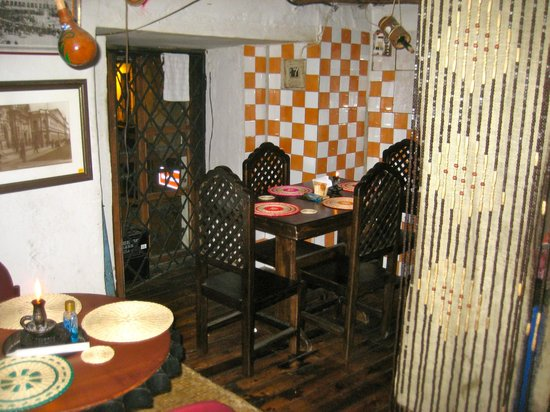 Cafe Dios No Muere:                                                       One of the dining areas...notice the tiles