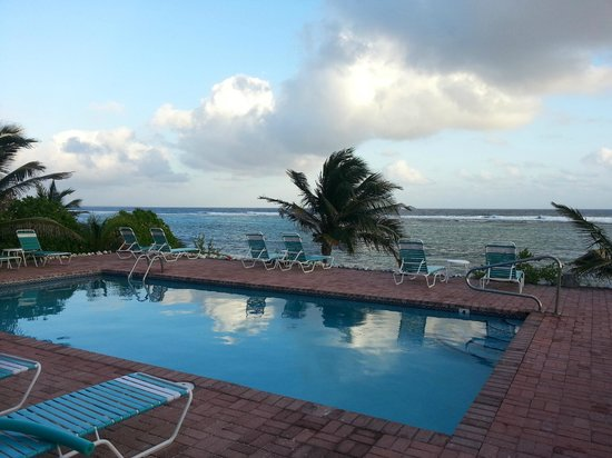 Bodden Town, Grand Cayman:                                     Standing by the pool looking out at the ocean