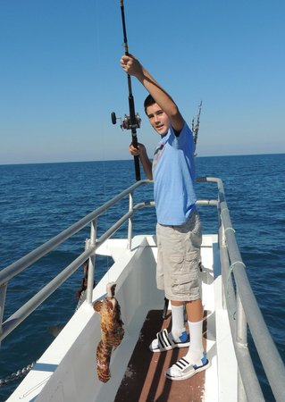 His first catch fish on picture of orlando princess for Deep sea fishing near orlando