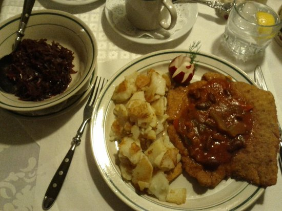 Little Schnitzel House:                   Schnitzel with tomato sauce and peppers (can't remember the menu name) and a s