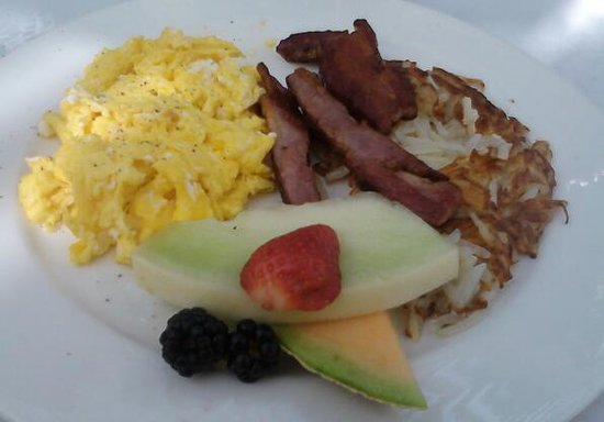 The Lafayette Hotel, Swim Club & Bungalows:                   Wild Boar Bacon with Fresh fruit and Scrambled Egg.                 