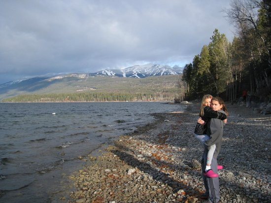 Bay Point on the Lake :                   Kids on Bay Point beach, looking toward Big Mountain ski slopes
